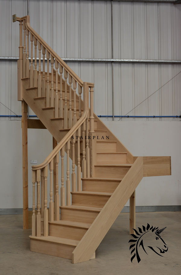 Oak cut string staircase with continuous handrails