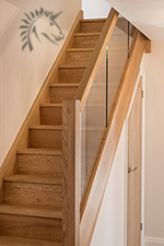 Preston oak staircase with a glass balustrade infill