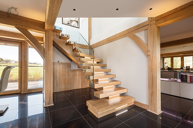 frameless glass balustrade on a oak x vision staircase