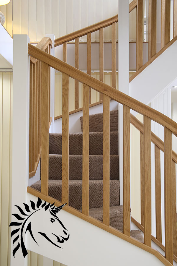 Staircases in oak and white can still offer a striking look over a simple painted stairway