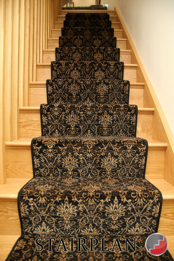 Oak staircase with a carpet runner.