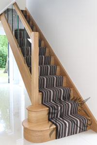 Houston Oak Staircase With Glass Balustrade Panels.