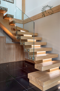 oak X-Vision staircase with frameless glass balustrade