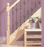 Staircase with metal balusters