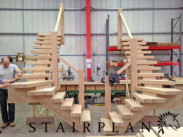 a pair of x-vision winder staircases in select oak