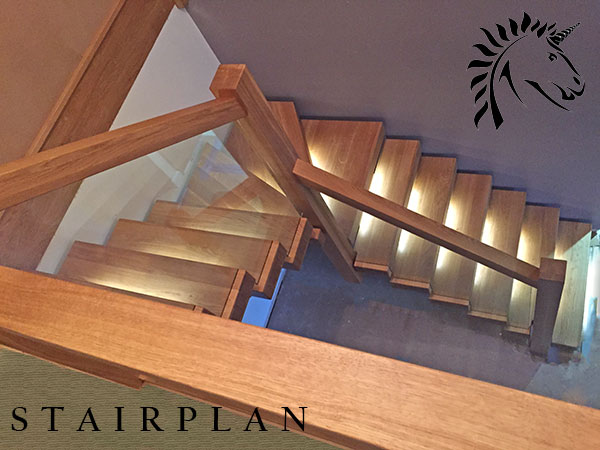 Oak X-Vision staircase with LED lights and the glass is set into the treads