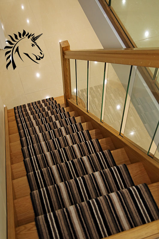 Oak Staircases With Panels Of Glass For The Balustrades