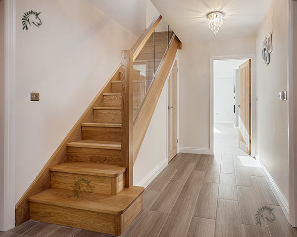 Preston Oak staircases with glass balustrading