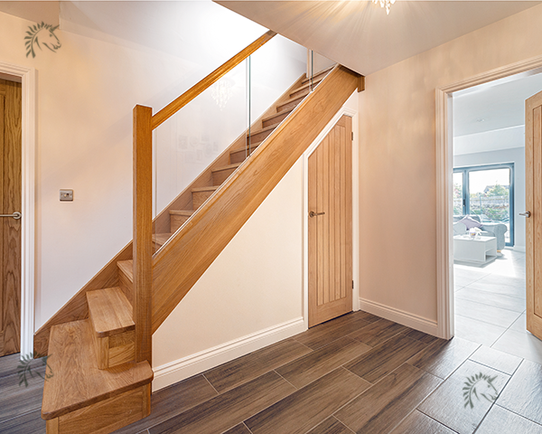 solid oak staircase with glass blustrade infill panels