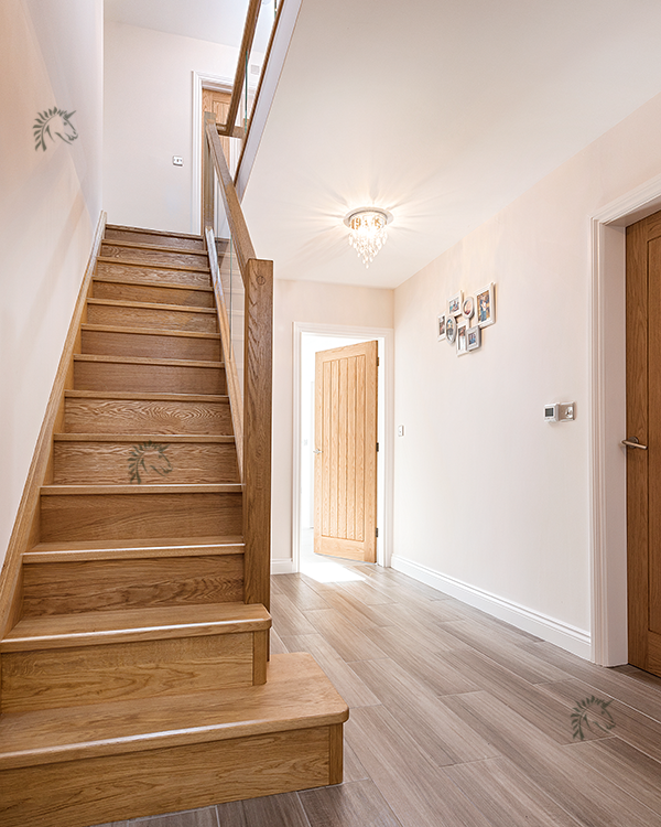 Preston staircase with solid oak treads and risers with glass infill