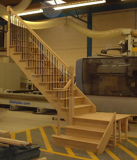 Oak Cut String Staircase with Bespoke Metal Balustrades